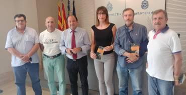 Una visita a l'Alcúdia i el VI Campionat de llançament de pinyol de dàtil i d'oliva per a celebrar el 121 aniversari de la troballa de la Dama d'Elx